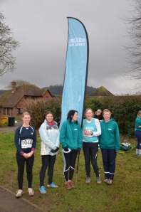 Epsom Ladies with their flag on a cold day in february - before the snow arrived.